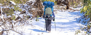 Backpacker on a Snowy Trail